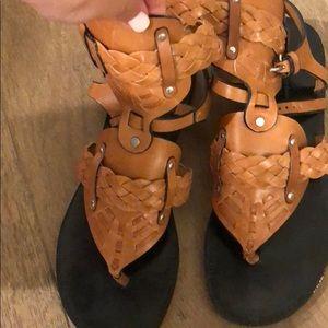 A tall brown sandal